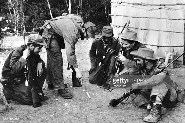 During the revolution Fidel Castro and Che Guevara surrounded by guerillas 19561959 Cuba