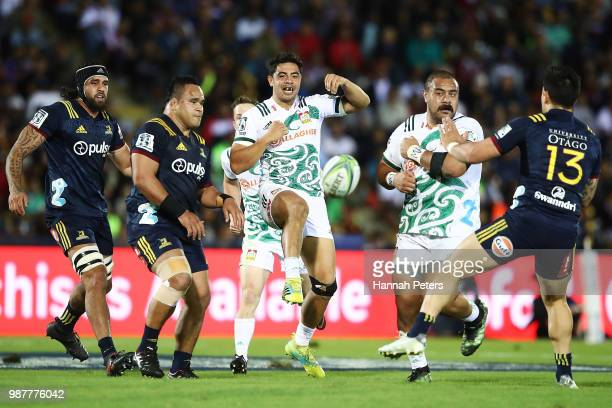during the round 17 Anton LienertBrown of the Chiefs kicks the ball through during the Super Rugby match between the Highlanders and the Chiefs at...
