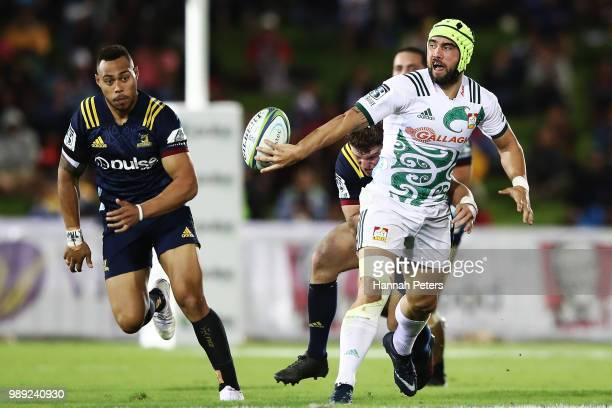 during the round 17 Charlie Ngatai of the Chiefs offloads the ball during the Super Rugby match between the Highlanders and the Chiefs at ANZ...