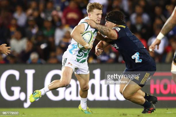 during the round 17 Damian McKenzie of the Chiefs makes a break during the Super Rugby match between the Highlanders and the Chiefs at ANZ National...