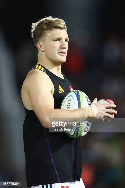 during the round 17 Damian McKenzie of the Chiefs warms up ahead of the Super Rugby match between the Highlanders and the Chiefs at ANZ National...