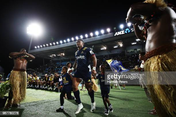 during the round 17 Waisake Naholo of the Highlanders runs out for the Super Rugby match between the Highlanders and the Chiefs at ANZ National...