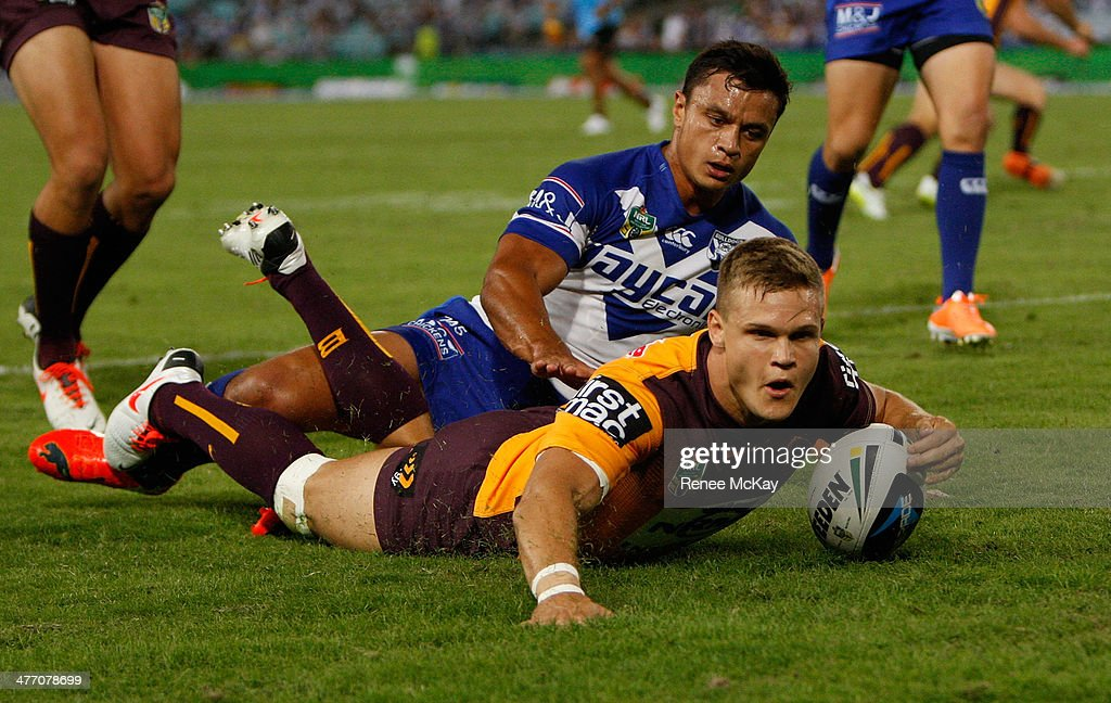 during the round one NRL match Dale Copley scores a try in the tackle of Sam Perrett during the Canterbury-Bankstown Bulldogs and the Brisbane Broncos at ANZ Stadium on March 7, 2014 in Sydney, Australia.