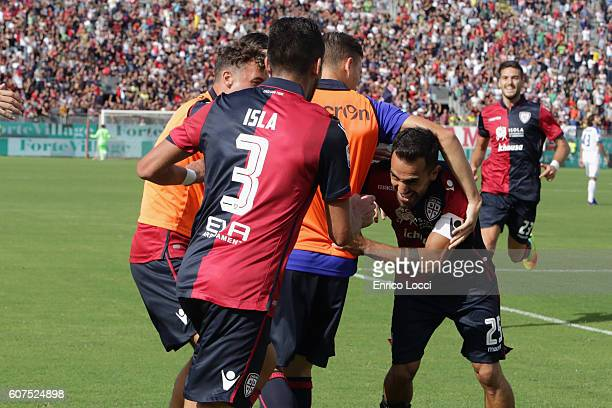 Marco Sau of Cagliari celebrates his goal with the team mates CAGLIARI ITALY SEPTEMBER 18 during the Serie A match between Cagliari Calcio and...