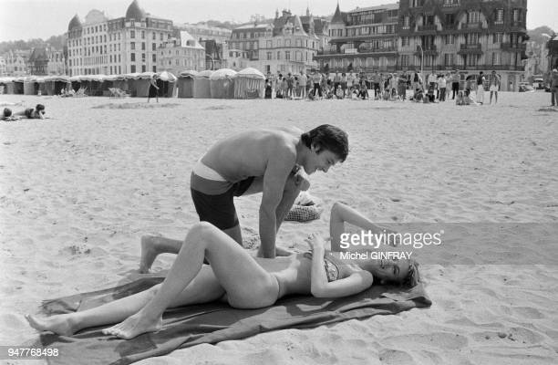 During the shooting of Three Men to be Shot Down by Jacques Deray French actor Alain Delon and his female counterpart Dalila di Lazzarogo go swimming...