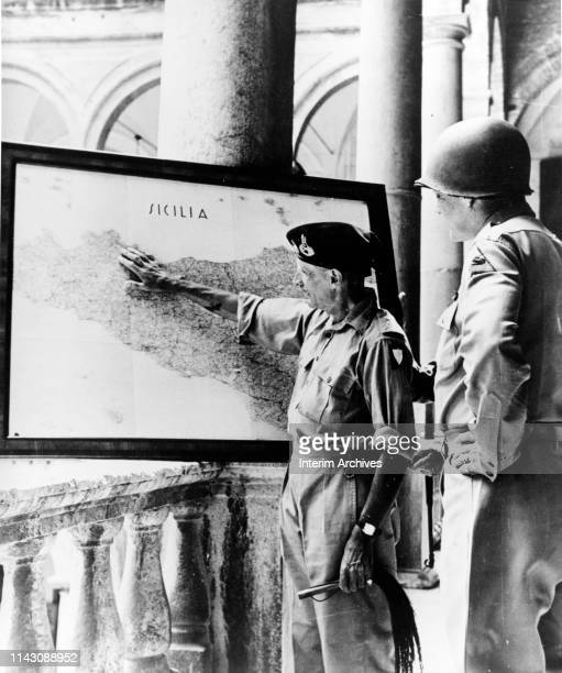During the Sicily Campaign, British Lieutenant General Bernard Montgomery points to a map of Sicily while US Army Lieutenant General George S Patton...