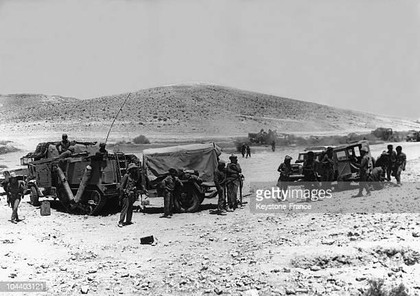 During the SixDay War an Israeli motorized unit is making a halt in the Sinaï Desert