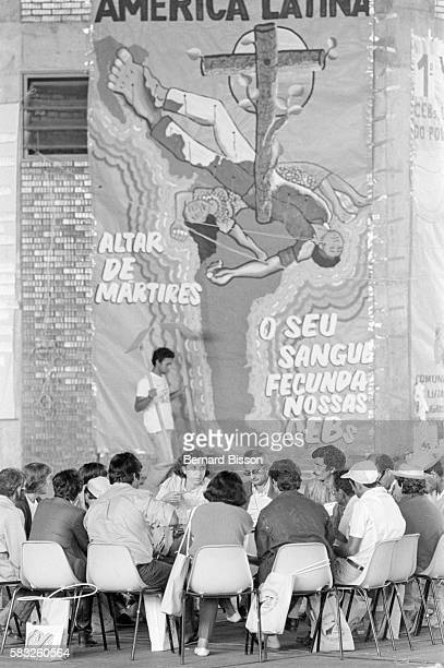 During the sixth meeting of the ecclesial base communities of Liberation Theology delegates gather beneath a huge banner proclaiming May the blood of...