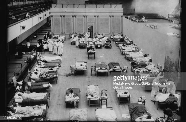 OCTOBER 1918 During the Spanish Flu pandemic the Oakland Civic Auditorium was converted into a makeshift infirmary This photo shows the women's ward...