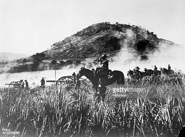 During the SpanishAmerican War Battery B of the 4th Artillery shells the blockhouse at Coamo Puerto Rico on August 9 1898 | Location Coamo Puerto Rico