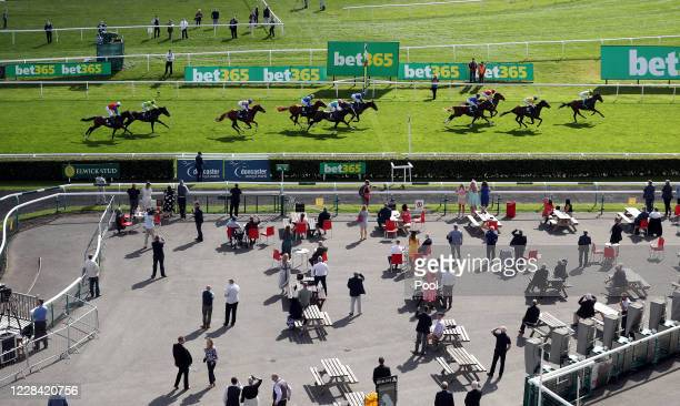 During the St Leger Festival at Doncaster Racecourse on September 9, 2020 in Doncaster, England. As part of a pilot scheme to reintroduce the public...