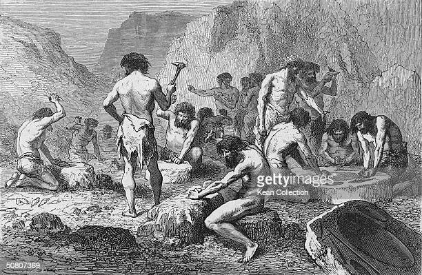 During the Stone Age a group of men hammer at rock in order to manufacture flints Stone Age