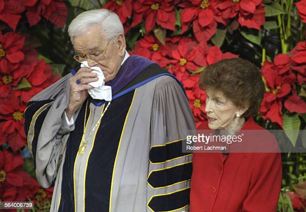During the Sunday morning service on December 19, 2004 at the Crystal Cathedral in Garden Grove, Robert H. Schuller reacts, wiping tears from his...