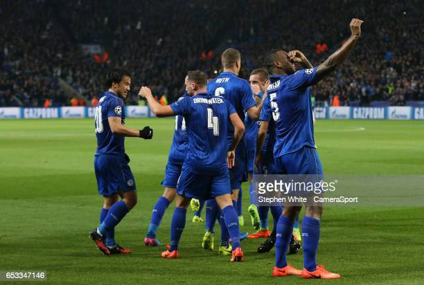 Leicester City's Wes Morgan celebrates scoring his sides first goal LEICESTER ENGLAND MARCH 14 during the UEFA Champions League Round of 16 second...