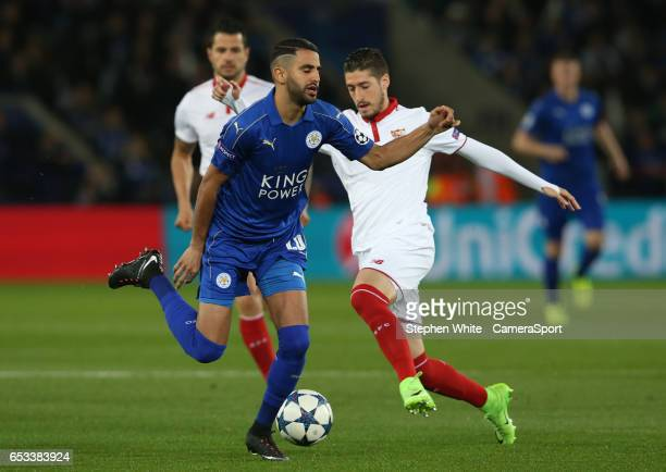 Leicester City's Riyad Mahrez and Sevilla's Sergio Escudero LEICESTER ENGLAND MARCH 14 during the UEFA Champions League Round of 16 second leg match...