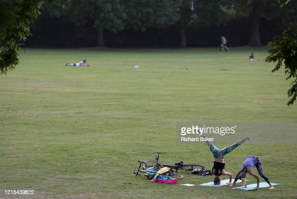 During the UK's Coronavirus lockdown, the May Bank Holiday brought warm temperatures for Londoners who stayed late to exercise, young women practice...