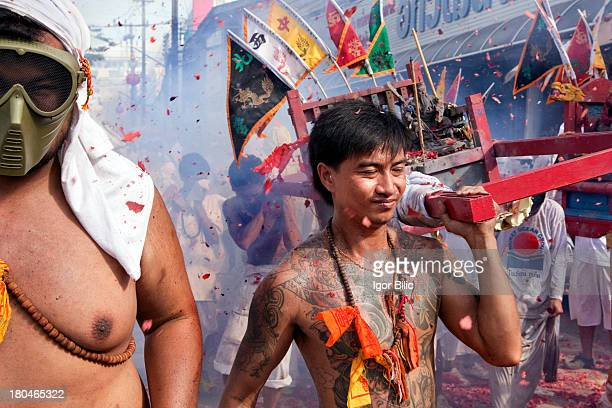 During the Vegetarian festivals street parade in Phuket, Thailand, firecrackers are used in large quantities. Somethimes they more look like bomb...