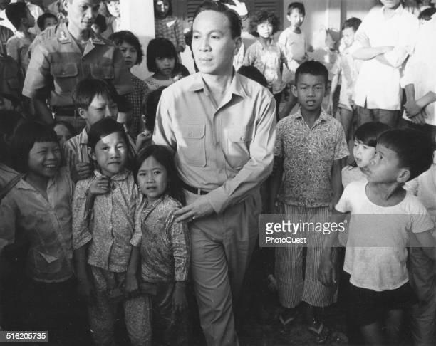 During the Vietnam War South Vietnamese President Nguyen Van Thieu tours a refugee center in the Mekong Delta Vietnam 1968