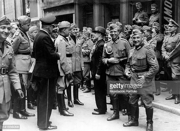 During the visit to Metz of an Italian delegation Ministry of Foreign Affairs Galeazzo Ciano speaking with a civilian Metz July 1940