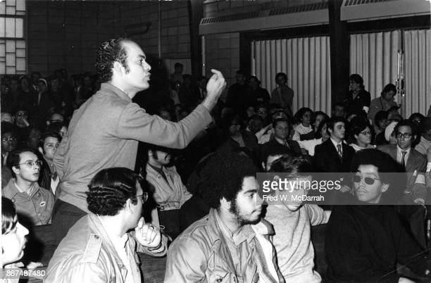 During the Young Lords' takeover of the First Spanish Methodist Church an unidentified man stands and speaks as other listen among them the group's...