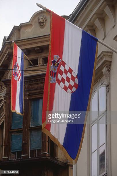 During the Yugoslavian Civil War, flags representing the Republic of Croatia hangs from a government building, where the ministries are guarded by...