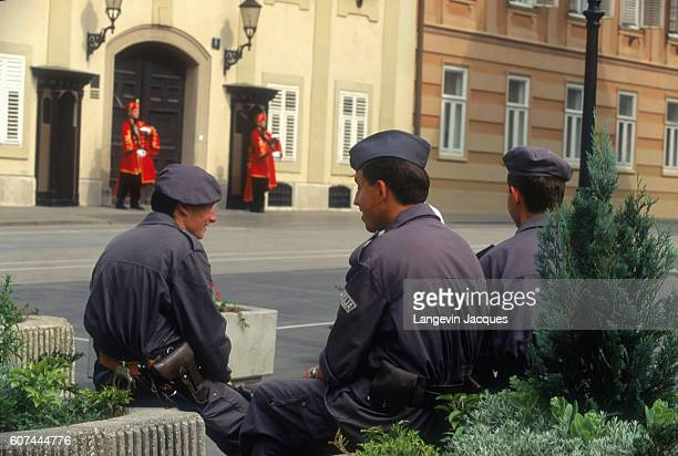 During the Yugoslavian Civil War, government buildings and ministries are guarded by sentries with the Croatian Territorial Army. A few soldiers rest...