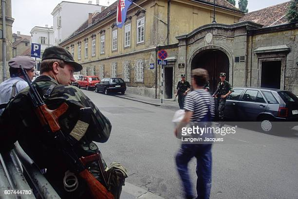 During the Yugoslavian Civil War, government buildings and ministries are guarded by sentries with the Croatian Territorial Army. A few soldiers...