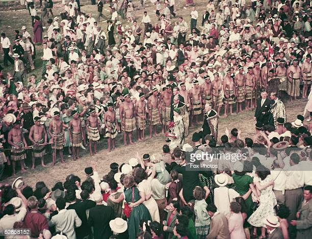 During their foreign tour of 1954 Queen Elizabeth II and Prince Philip Duke of Edinburgh walk through the crowd at a reception by about 20 000 Maoris...