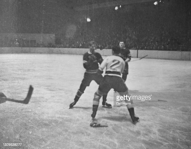 During third period action, Bill Cook of the Rangers and Red Durron of the Americans engage in a fist fight.