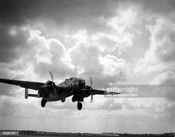 During World War 2 a bomber from the 477th Bombardment Group the Tuskegee Airmen takes off Fort Knox's Godman Field Louisville Kentucky December 13...