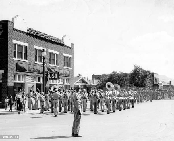During World War 2, African American soldiers in a marching band perform in front of a USO club, Texas, 1942.