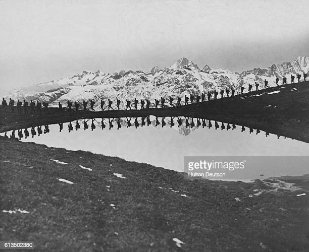During World War I soldiers of what will become Yugoslavia march past a mountain lake in the future Yugoslavia then part of the AustriaHungary