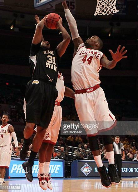 Durley of the Wichita State Shockers goes to the hoop against Chris Hines of the Alabama Crimson Tide during the 2011 NIT Championship game on March...
