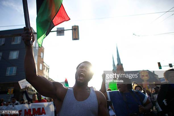 Durmel Coleman marches as the flag bearer joining protestors to demonstrate over the death of Freddie Gray on April 30 2015 in Philadelphia...