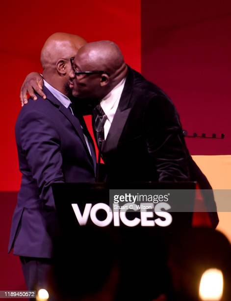 Duro Olowu presents Edward Enninful with the Global VOICES Award 2019 during the gala dinner at #BoFVOICES on November 22 2019 in Oxfordshire England