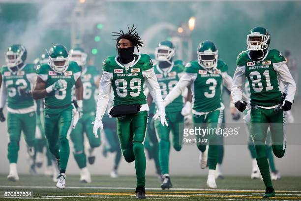 Duron Carter and Bakari Grant of the Saskatchewan Roughriders take the field for the game between the Edmonton Eskimos and Saskatchewan Roughriders...