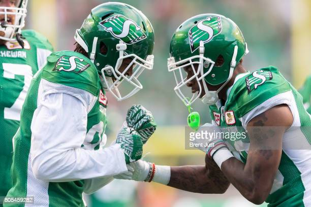 Duron Carter and Caleb Holley of the Saskatchewan Roughriders celebrate after first half touchdown in the game between the Winnipeg Blue Bombers and...