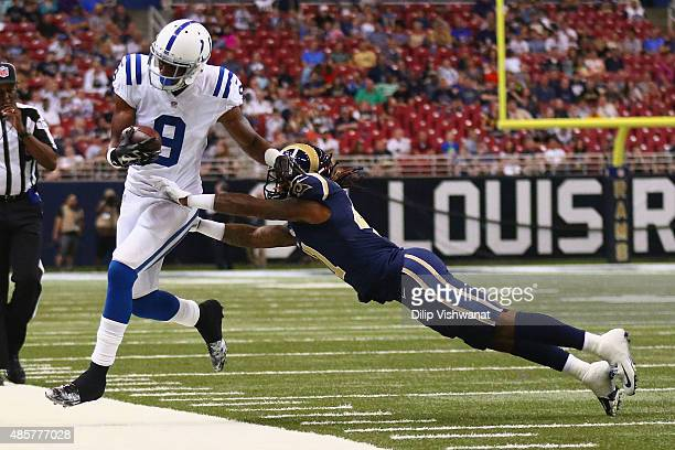 Duron Carter of the Indianapolis Colts is pushed out of bounds by Trovon Reed of the St Louis Rams in the second quarter during a preseason game at...