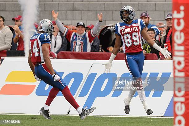 Duron Carter of the Montreal Alouettes is joined by teammate Brandon London to celebrate his touchdown during the CFL game against the Saskatchewan...