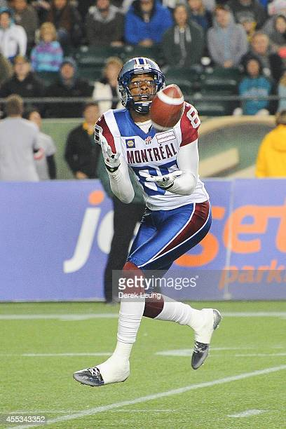 Duron Carter of the Montreal Alouettes makes a catch against the Edmonton Eskimos during a CFL game at Commonwealth Stadium on September 12 2014 in...