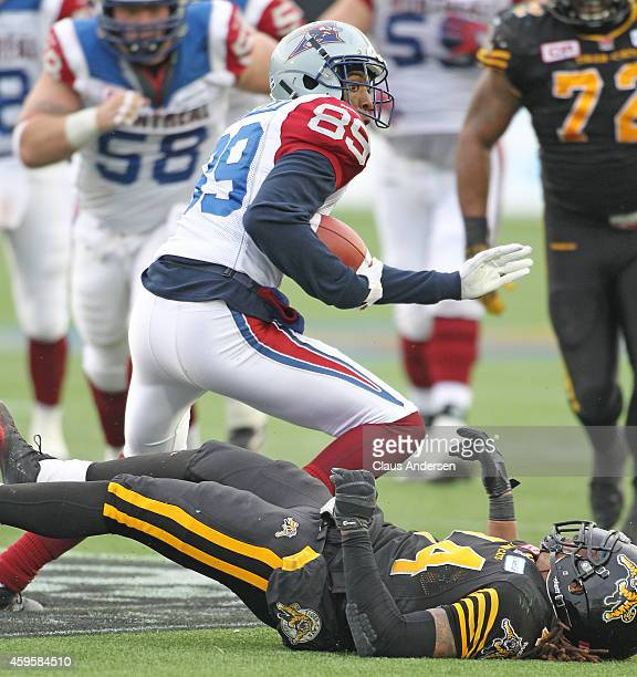 Duron Carter of the Montreal Alouettes runs with a catch against the Hamilton TigerCats during the CFL football Eastern Conference Final at Tim...