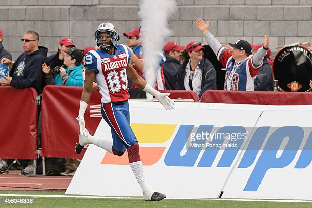 Duron Carter of the Montreal Alouettes scores a touchdown in the first half during the CFL game against the Saskatchewan Roughriders at Percival...
