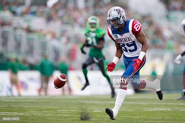 Duron Carter of the Montreal Alouettes tracks down a bouncing ball after a punt over his head in a game between the Montreal Alouettes and...