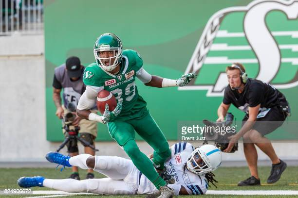Duron Carter of the Saskatchewan Roughriders after making a spectacular one handed catch for a touchdown in the game between the Toronto Argonauts...