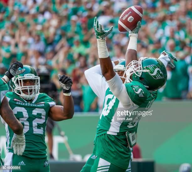 Duron Carter of the Saskatchewan Roughriders celebrates a touchdown with teammates in the game between the Toronto Argonauts and Saskatchewan...