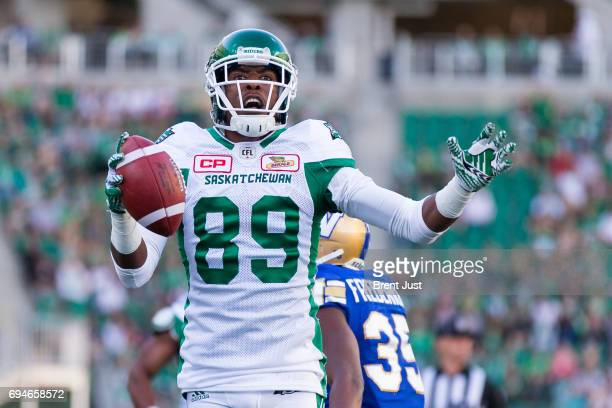 Duron Carter of the Saskatchewan Roughriders celebrates after scoring a first half touchdown in the preseason game between the Winnipeg Blue Bombers...