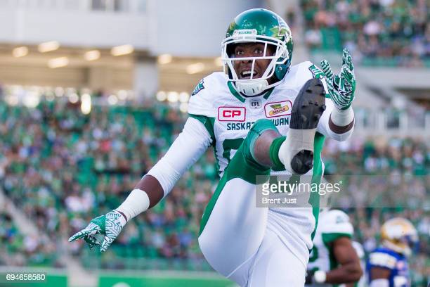 Duron Carter of the Saskatchewan Roughriders kicks the ball into the crowd after scoring a first half touchdown in the preseason game between the...