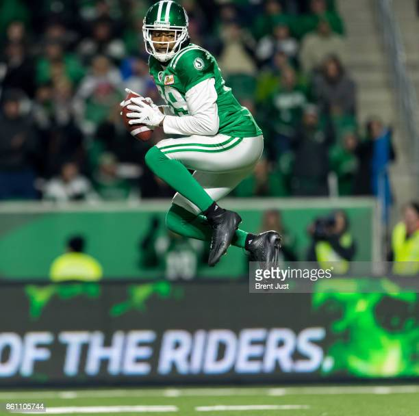 Duron Carter of the Saskatchewan Roughriders leaps in the air to celebrate a catch in the game between the Ottawa Redblacks and Saskatchewan...