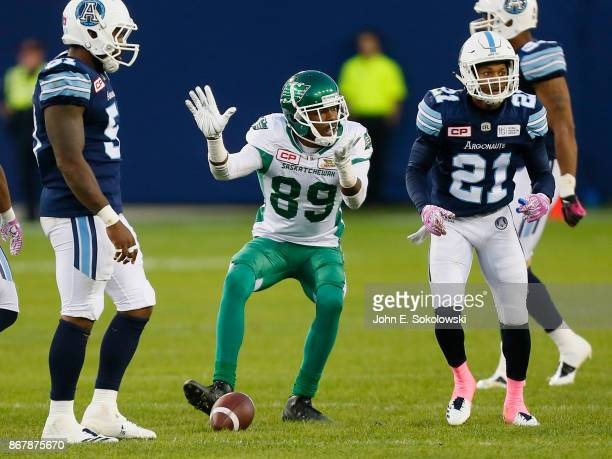 Duron Carter of the Saskatchewan Roughriders taunts Qudarius Ford of the Toronto Argonauts after a catch during a game at BMO field on October 7 2017...