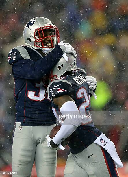 Duron Harmon and Darrelle Revis of the New England Patriots celebrate Revis' interception in the third quarter against the Indianapolis Colts of the...